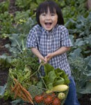 boy with garden veggies