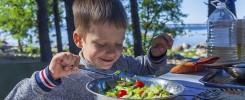 kid enjoying salad