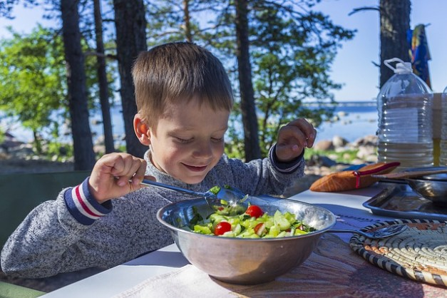 kid enjoying salad