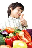 Kid giving the thumbs up to veggies